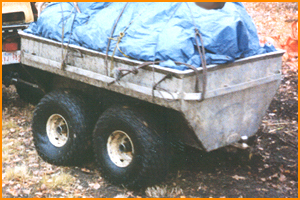 Putnam Bogie ATV Trailer loaded with camping gear